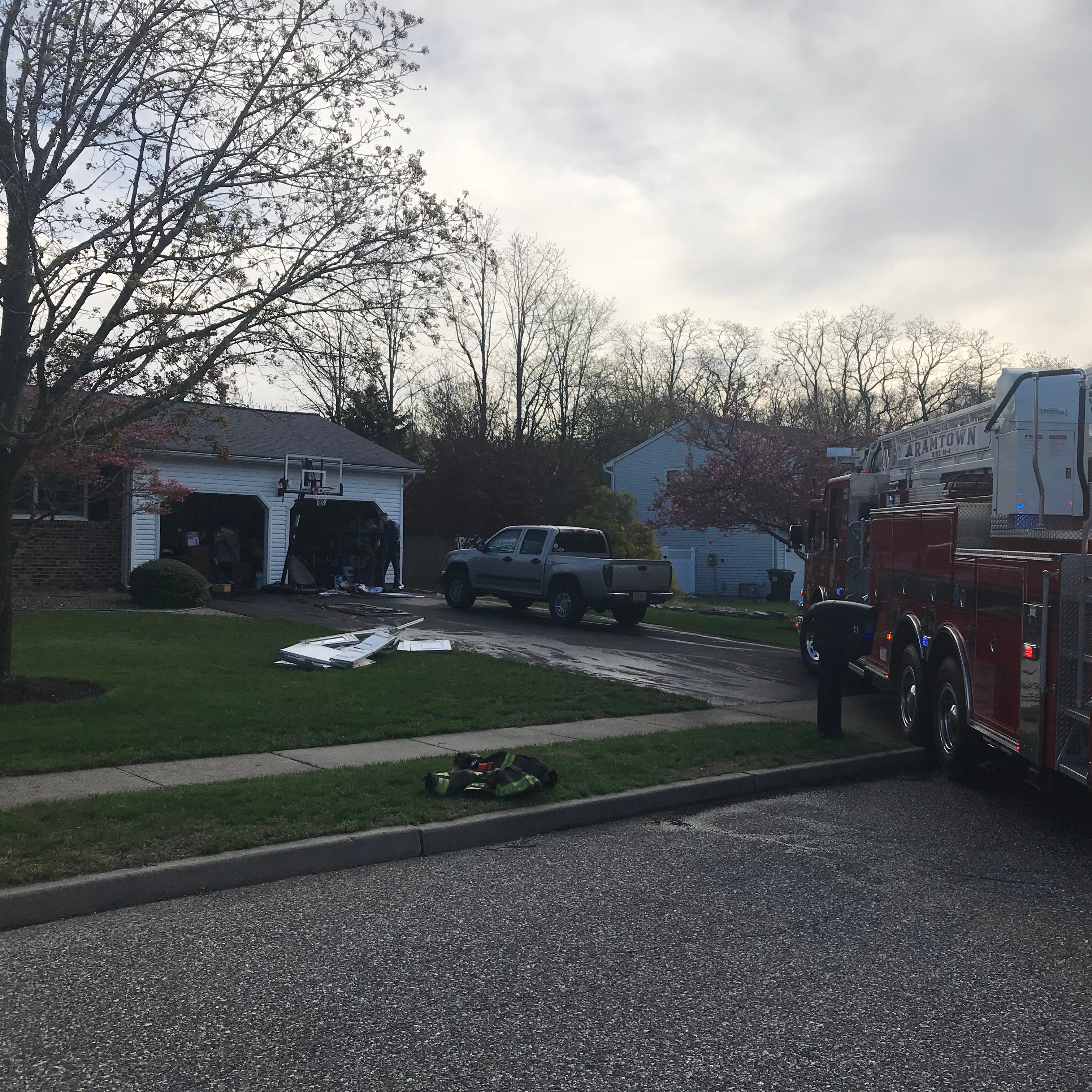 Howell man hurt trying to put out garage fire