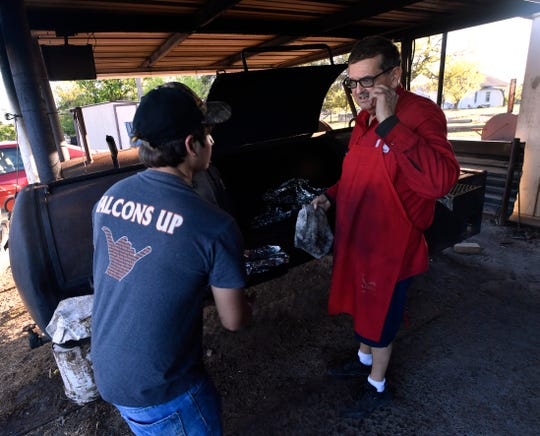 Lynn Owens gives instructions to Jonathan Salazar Friday, part of the latest class of high school students Owens has employed at his restaurant since opening in 1993.