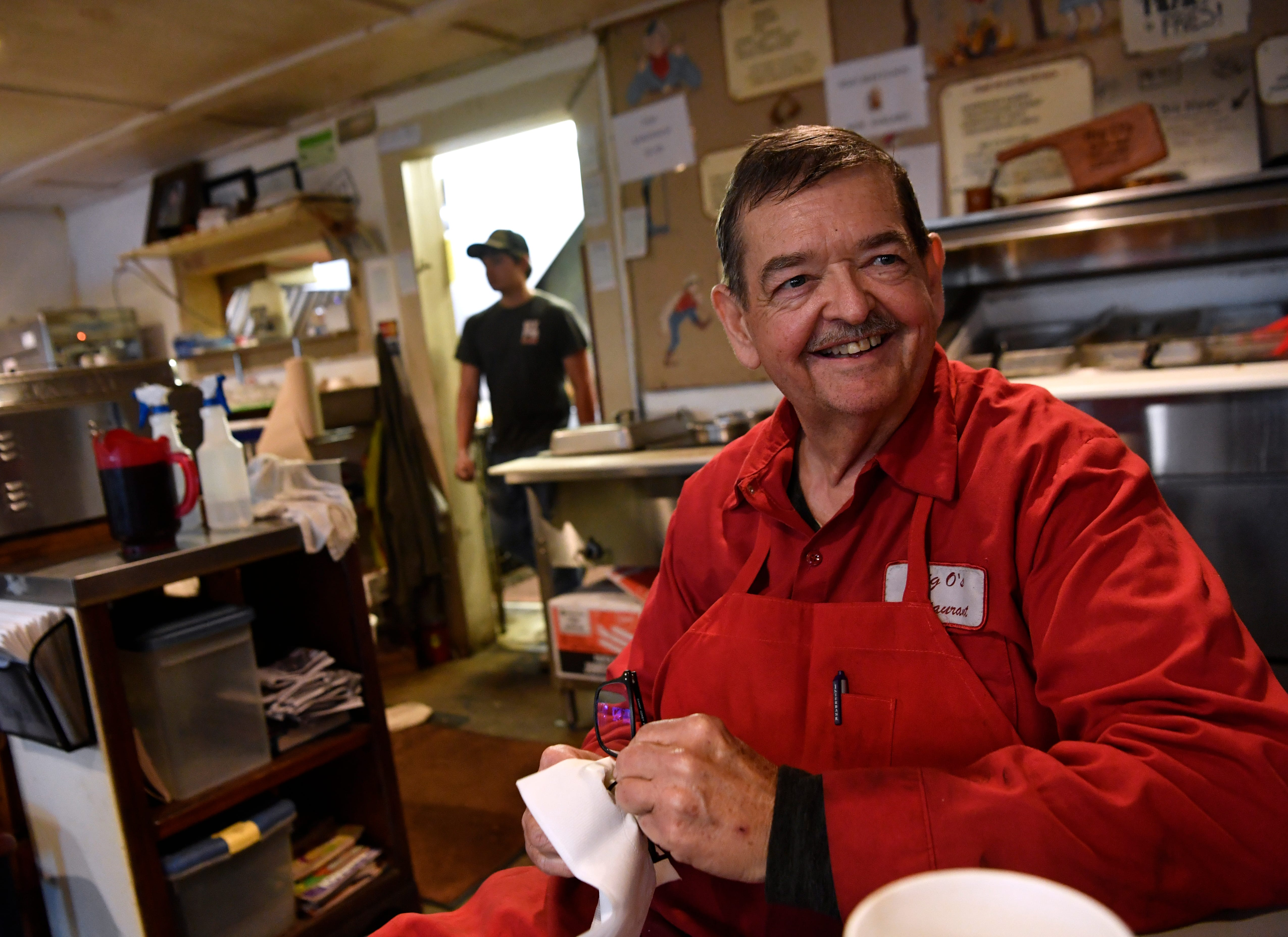 Lynn Owens, the own of Big O's Restaurant in Valera, sits down for a few minutes during a busy Friday last week. He said he is honored that another restaurant, Rancho Pizzeria in Coleman, has created a pizza using his brisket