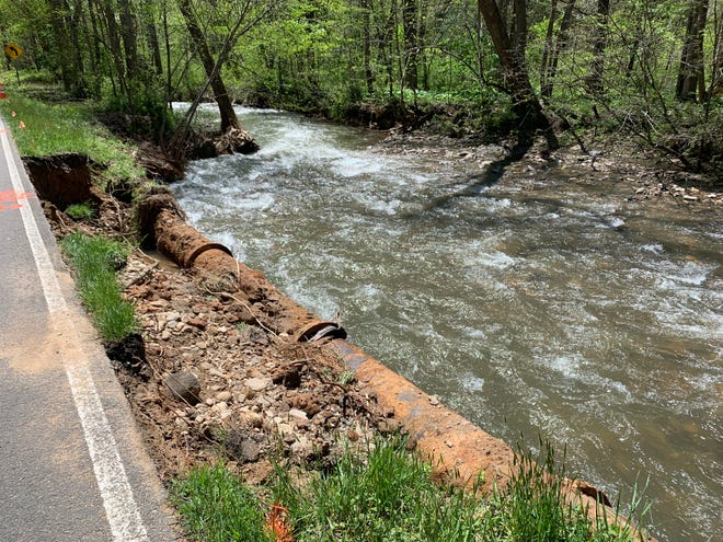 A water pipe along Bee Tree Road in Swannanoa ruptured when the stream bank washed out in flooding after heavy rain on April 19.