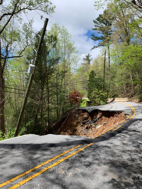 Half of Old Roll Road is washed out just west of Town Mountain Road in Asheville on April 21. The road collapsed after heavy rains and flooding on April 19.
