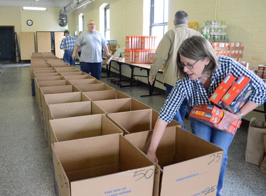 Sarah Engster was one of the volunteers packing boxes with food.