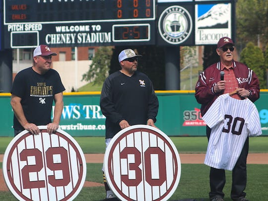 Former South Kitsap assistant baseball coach Don Smith is honored during Saturday's Tribute to Our Troops game against Graham-Kapowsin at Cheney Stadium. Smith's No. 30 is the second number to be retired by the team. Former head coach, the late Elton Goodwin, had his No. 29 previously retired.