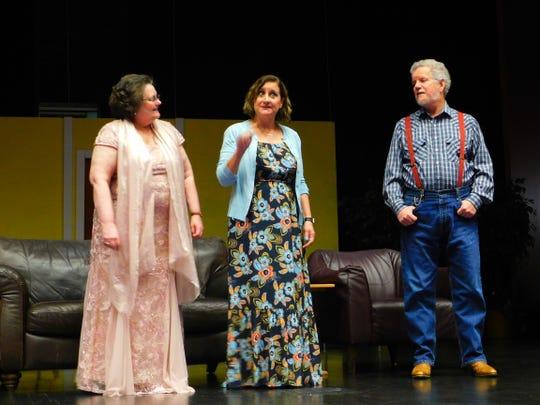 Jo Marie (Palmer Scheutzow, middle) shares some memories with Abigail (Kathleen Martin) and Joshua (Jerry Schneider).