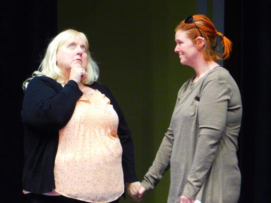 "Ann Sveen (left) and Rachel Dotson rehearse a scene from CSTOCK's ""The Inn at Rose Harbor."""