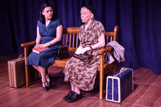 Carrie (Jenny Sellar, right) and Thelma (Karen Ventrice) meet in the bus station as Jenny begins her journey.