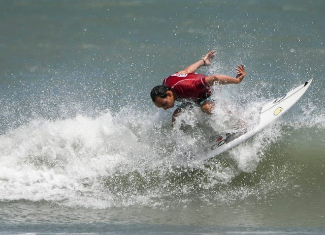 Nelson Oduber surfs during the Easter Surf Fest.