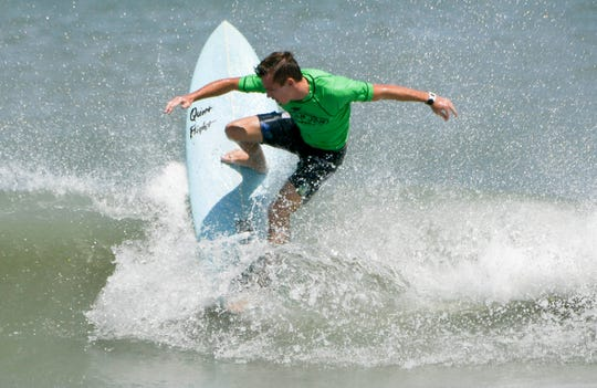 Jonathan Wallhauser cuts back on a wave during the Easter Surf Fest.