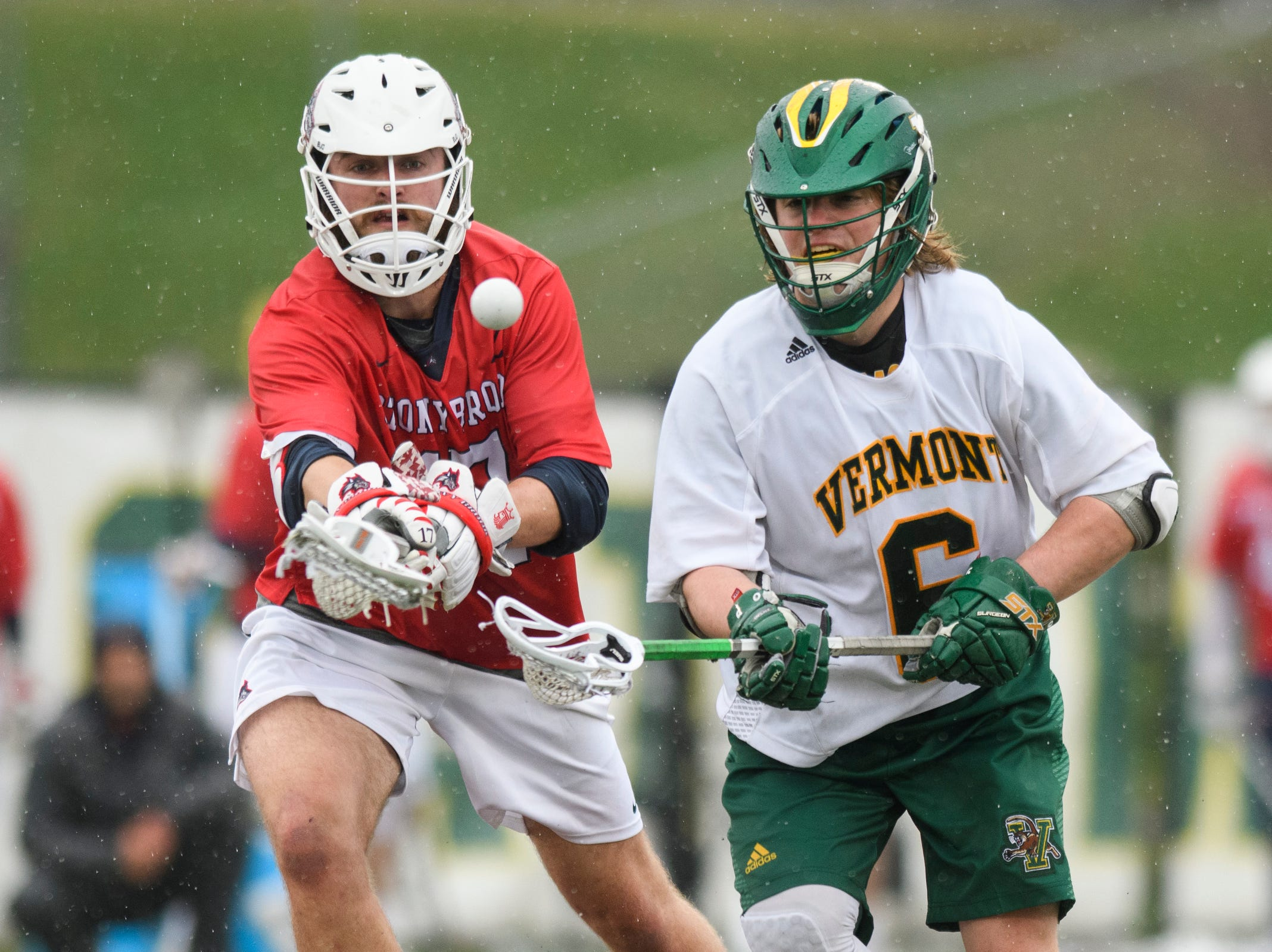 Vermont's Alex Semler (6) battles for the loose ball with Stony Brook's Ryland Rees (17) during the men's lacrosse game between the Stony Brook Sea Wolves and the Vermont Catamounts at Virtue Field on Saturday afternoon April 20, 2019 in Burlington, Vermont.