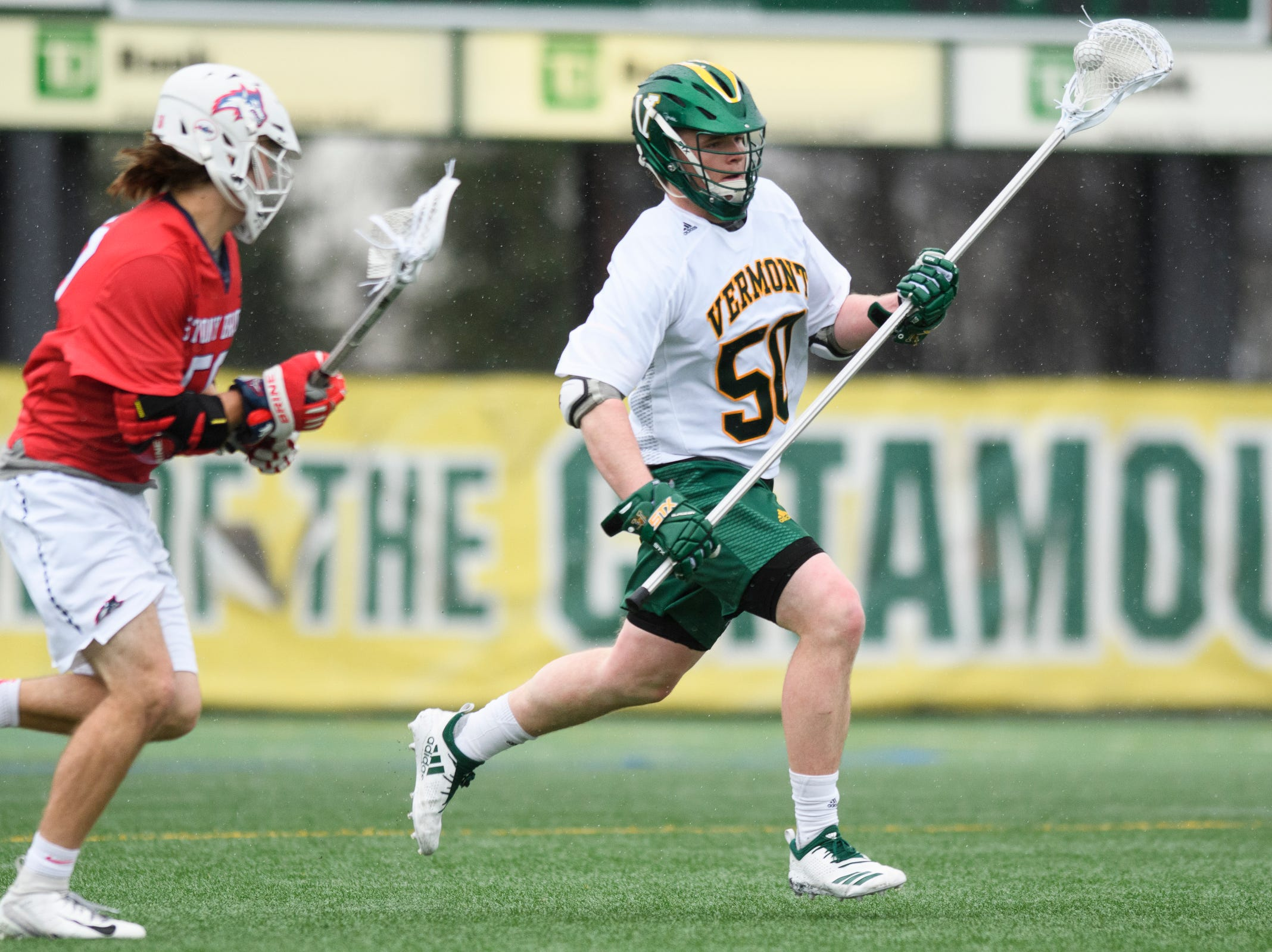 Vermont's Will Jones (50) runs down the field with the ball during the men's lacrosse game between the Stony Brook Sea Wolves and the Vermont Catamounts at Virtue Field on Saturday afternoon April 20, 2019 in Burlington, Vermont.