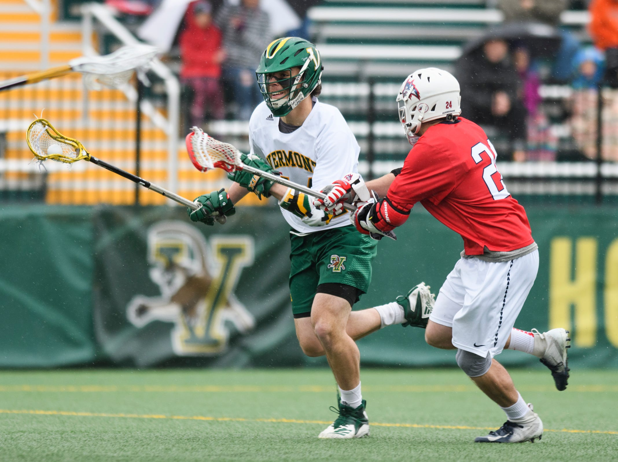 Vermont's Thomas McConvey (44) ruins past Stony Brook's Tom Dugan (24) during the men's lacrosse game between the Stony Brook Sea Wolves and the Vermont Catamounts at Virtue Field on Saturday afternoon April 20, 2019 in Burlington, Vermont.
