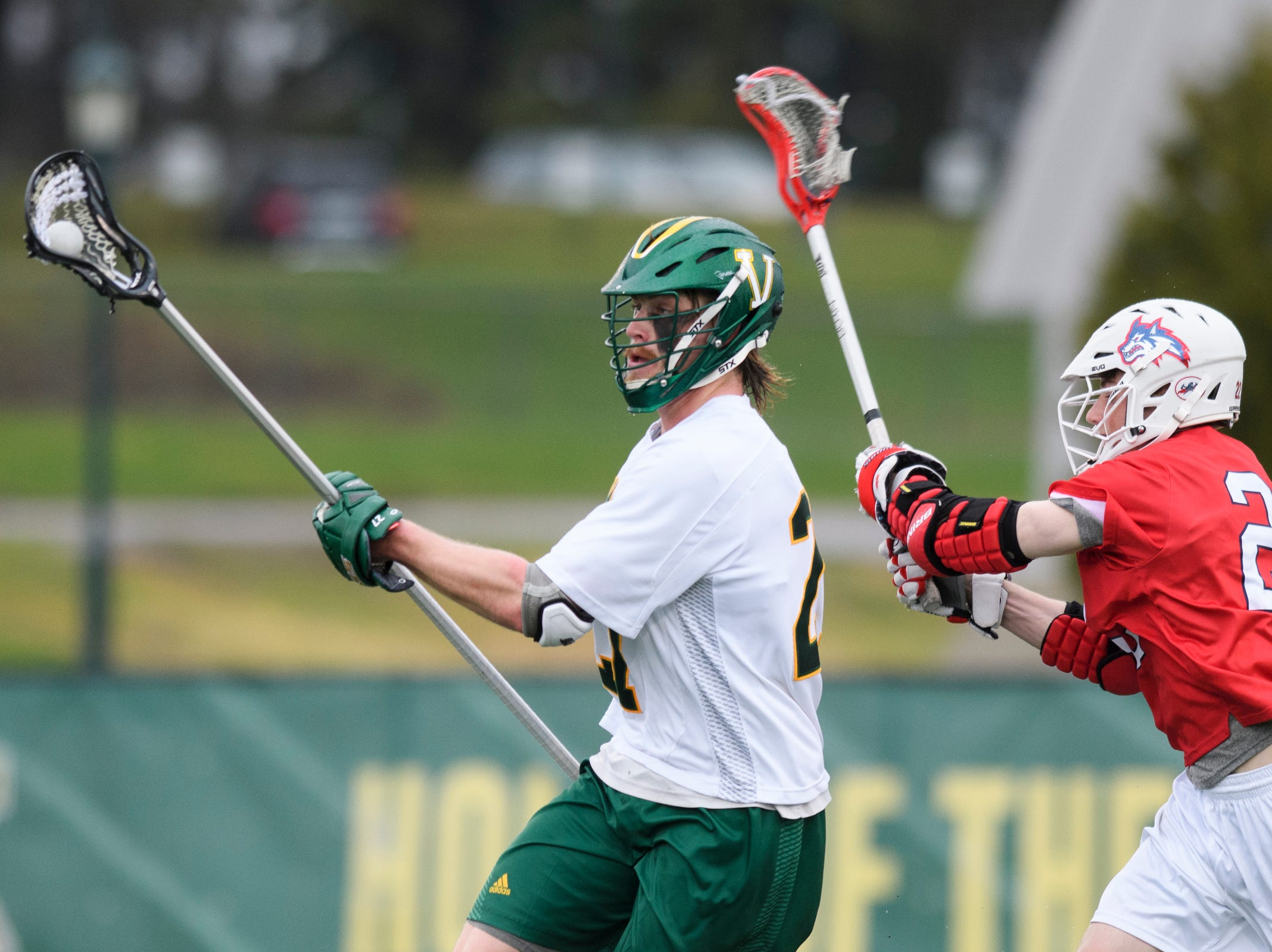 Vermont's Warren Jeffrey (27) runs past Stony Brook's Tom Haun (22) with the ball during the men's lacrosse game between the Stony Brook Sea Wolves and the Vermont Catamounts at Virtue Field on Saturday afternoon April 20, 2019 in Burlington, Vermont.