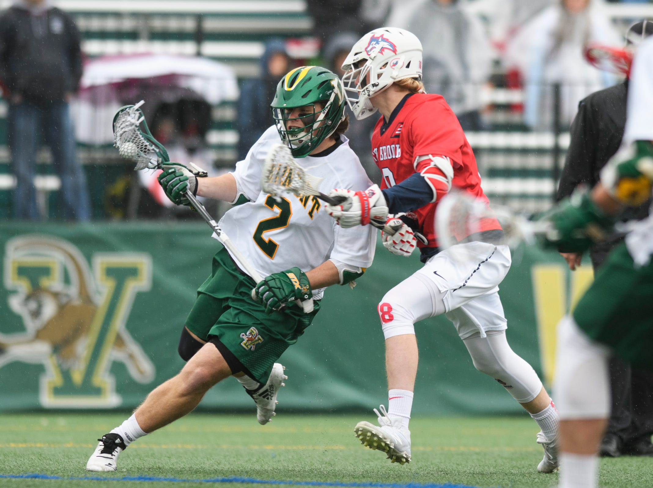 Vermont's Jack Knight (2) runs past Stony Brook's Harrison Matsuoka (18) with the ball during the men's lacrosse game between the Stony Brook Sea Wolves and the Vermont Catamounts at Virtue Field on Saturday afternoon April 20, 2019 in Burlington, Vermont.