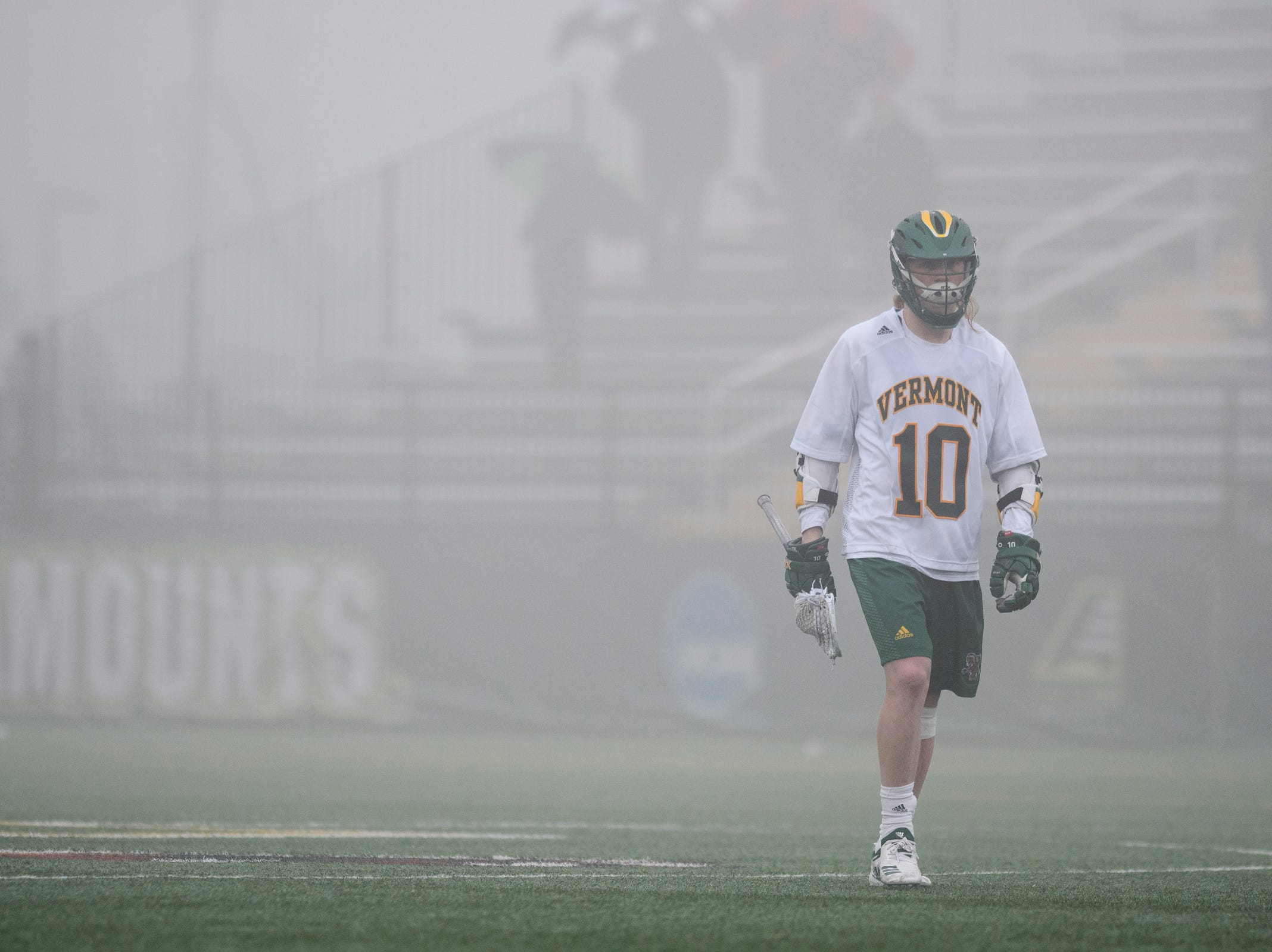 Vermont's David Closterman (10) walks on the field as the fog rolls in during the men's lacrosse game between the Stony Brook Sea Wolves and the Vermont Catamounts at Virtue Field on Saturday afternoon April 20, 2019 in Burlington, Vermont.