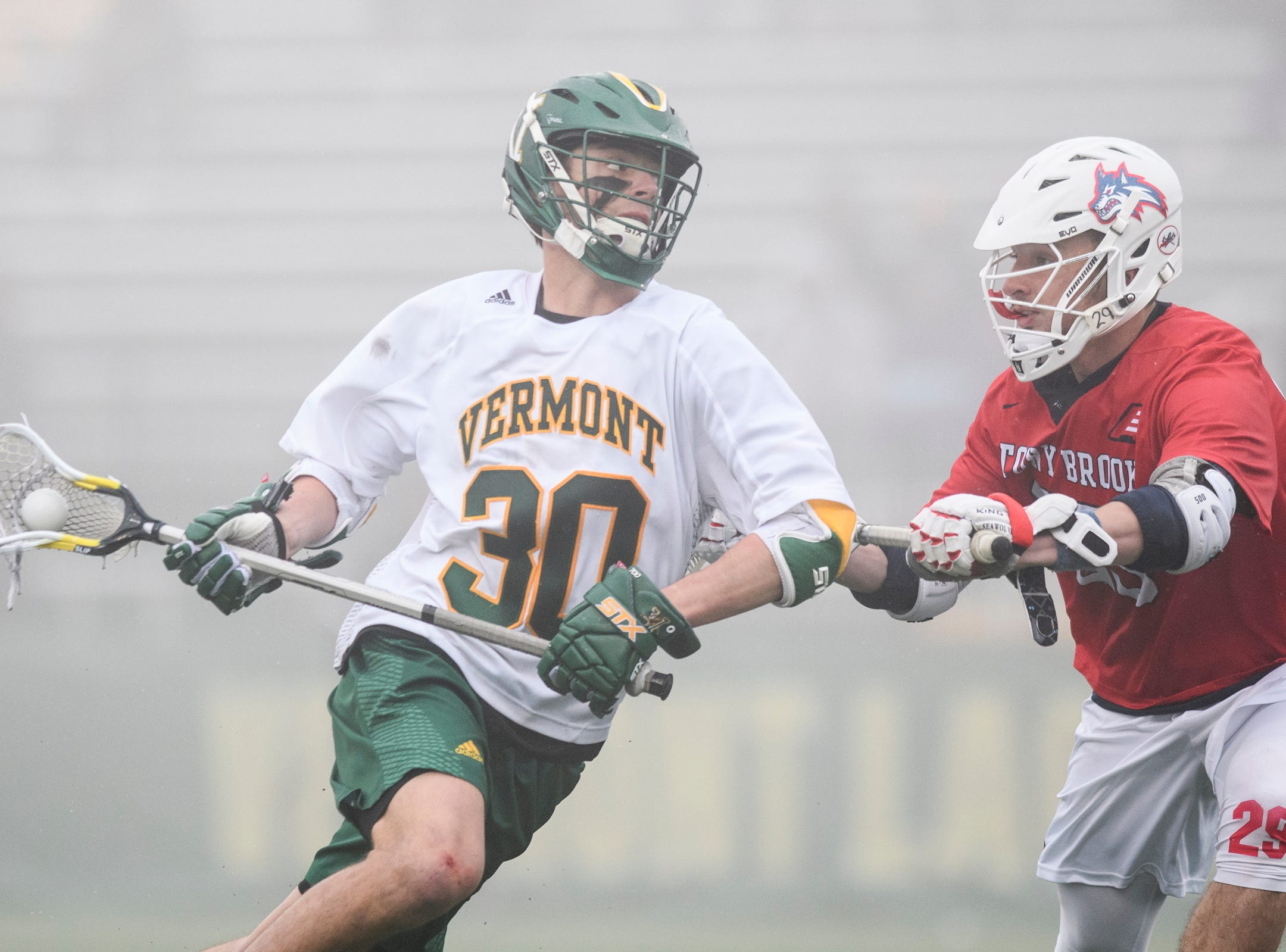 Vermont's Sal Iaria (30) runs past Stony Brook's Jimmy Morrell (29) with the ball during the men's lacrosse game between the Stony Brook Sea Wolves and the Vermont Catamounts at Virtue Field on Saturday afternoon April 20, 2019 in Burlington, Vermont.