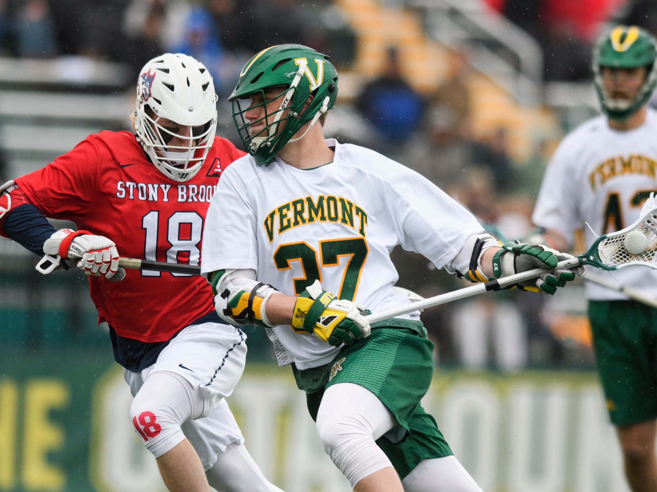 Vermont's Rob Hudson (37) looks to take a shot during the men's lacrosse game between the Stony Brook Sea Wolves and the Vermont Catamounts at Virtue Field on Saturday afternoon April 20, 2019 in Burlington, Vermont.