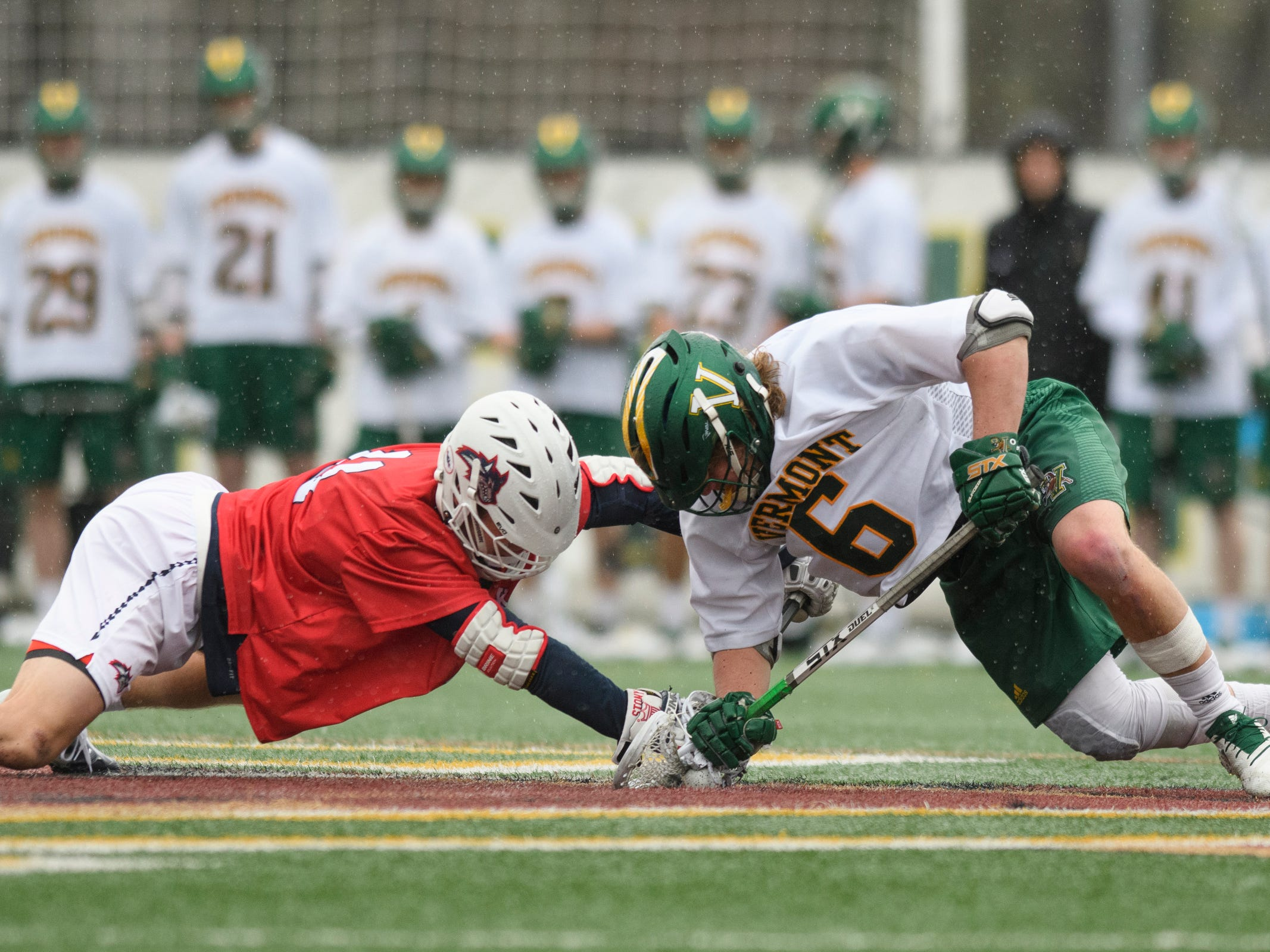Vermont's Alex Semler (6) battles for the tip off with Stony Brook's David Estrella (14) during the men's lacrosse game between the Stony Brook Sea Wolves and the Vermont Catamounts at Virtue Field on Saturday afternoon April 20, 2019 in Burlington, Vermont.