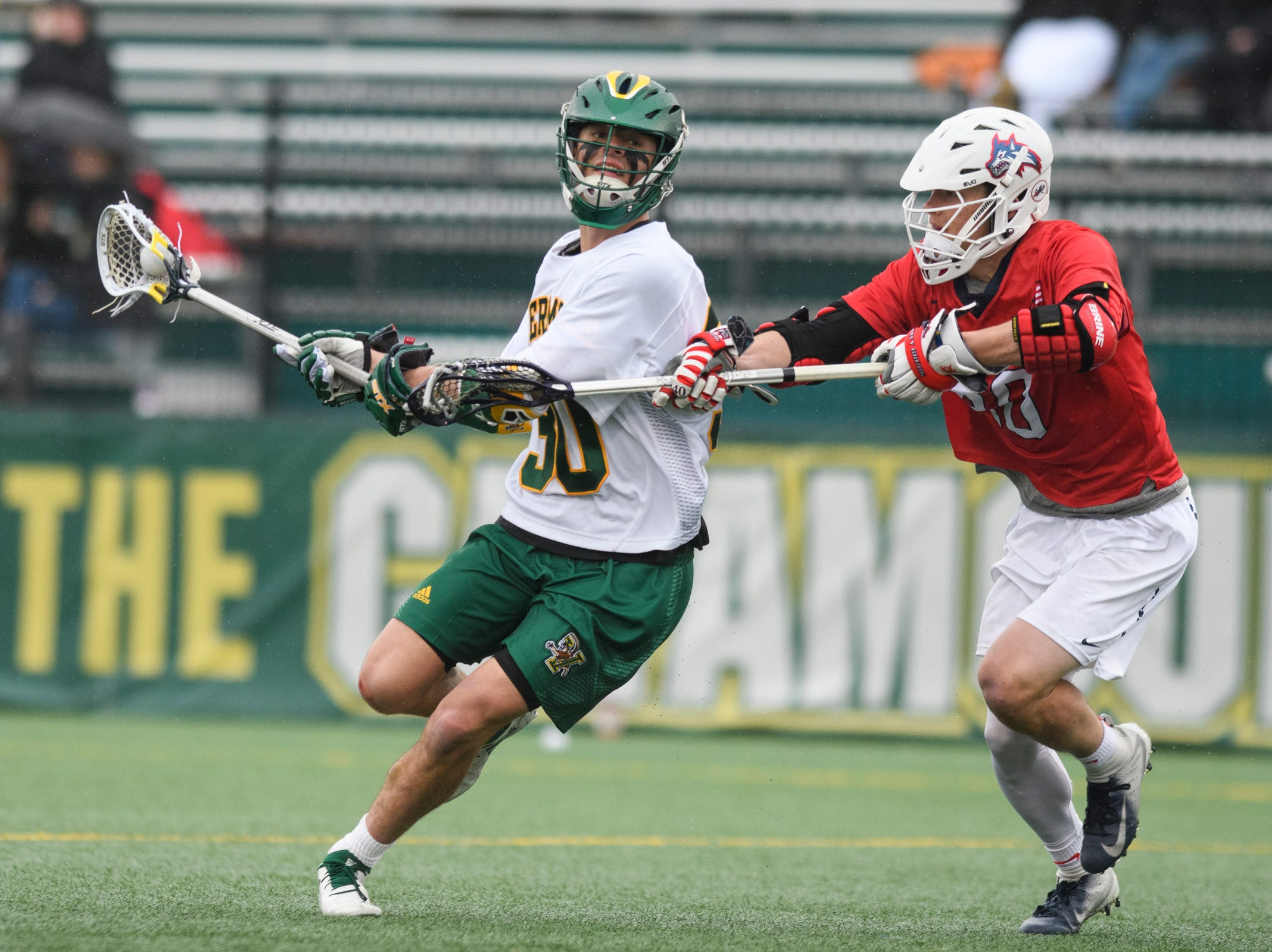 Vermont's Sal Iaria (30) runs with the ball during the men's lacrosse game between the Stony Brook Sea Wolves and the Vermont Catamounts at Virtue Field on Saturday afternoon April 20, 2019 in Burlington, Vermont.
