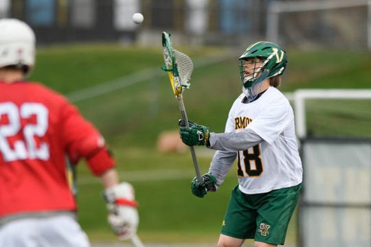 Vermont goalie Nick Washuta (18) passes the ball during the men's lacrosse game between the Stony Brook Sea Wolves and the Vermont Catamounts at Virtue Field on Saturday afternoon April 20, 2019 in Burlington, Vermont.