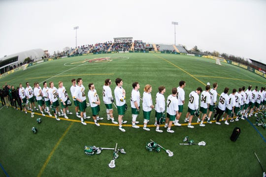 Vermont listens to the National Anthem during the men's lacrosse game between the Stony Brook Sea Wolves and the Vermont Catamounts at Virtue Field on Saturday afternoon April 20, 2019 in Burlington, Vermont.