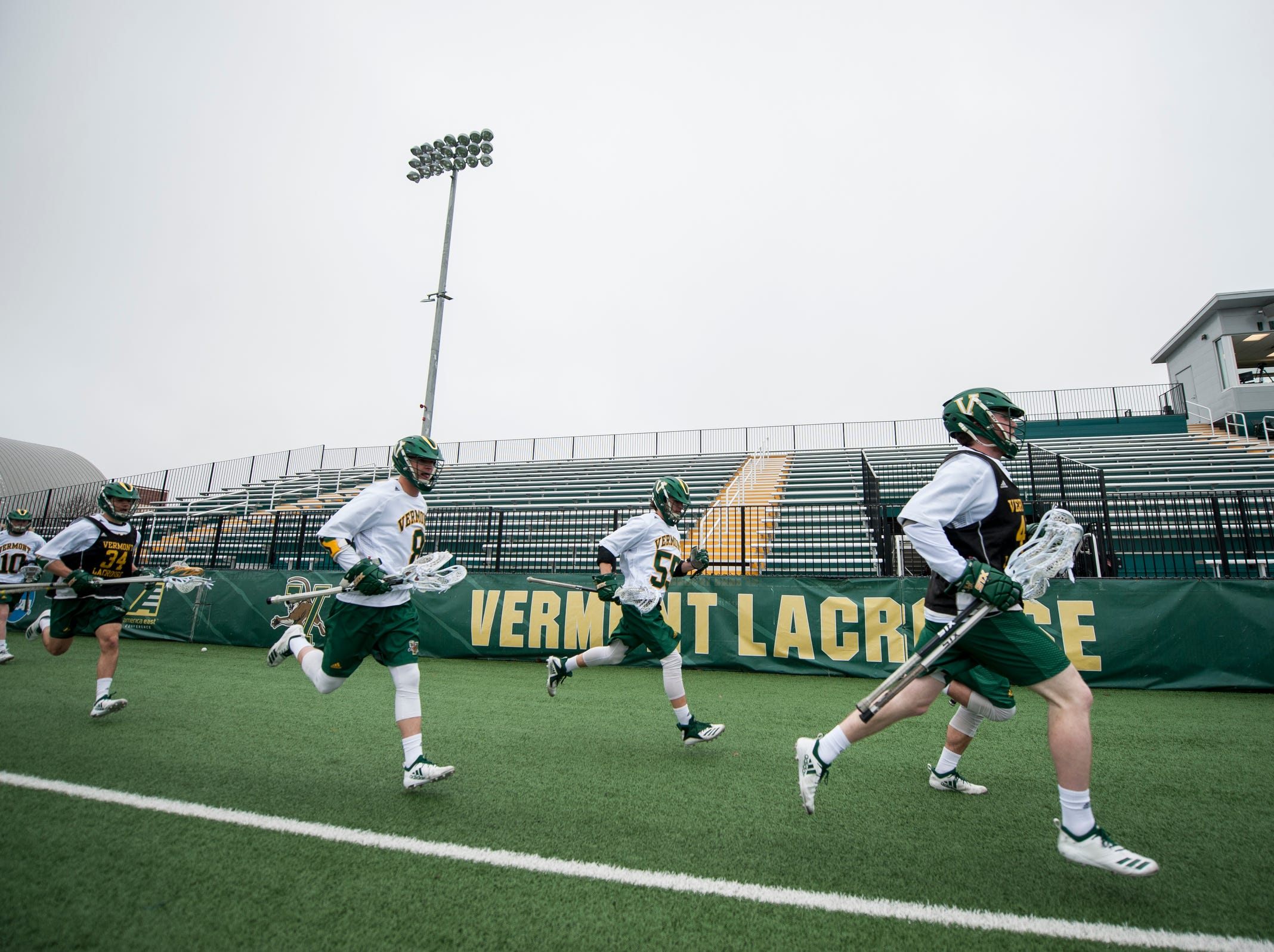 Vermont takes the field during the men's lacrosse game between the Stony Brook Sea Wolves and the Vermont Catamounts at Virtue Field on Saturday afternoon April 20, 2019 in Burlington, Vermont.