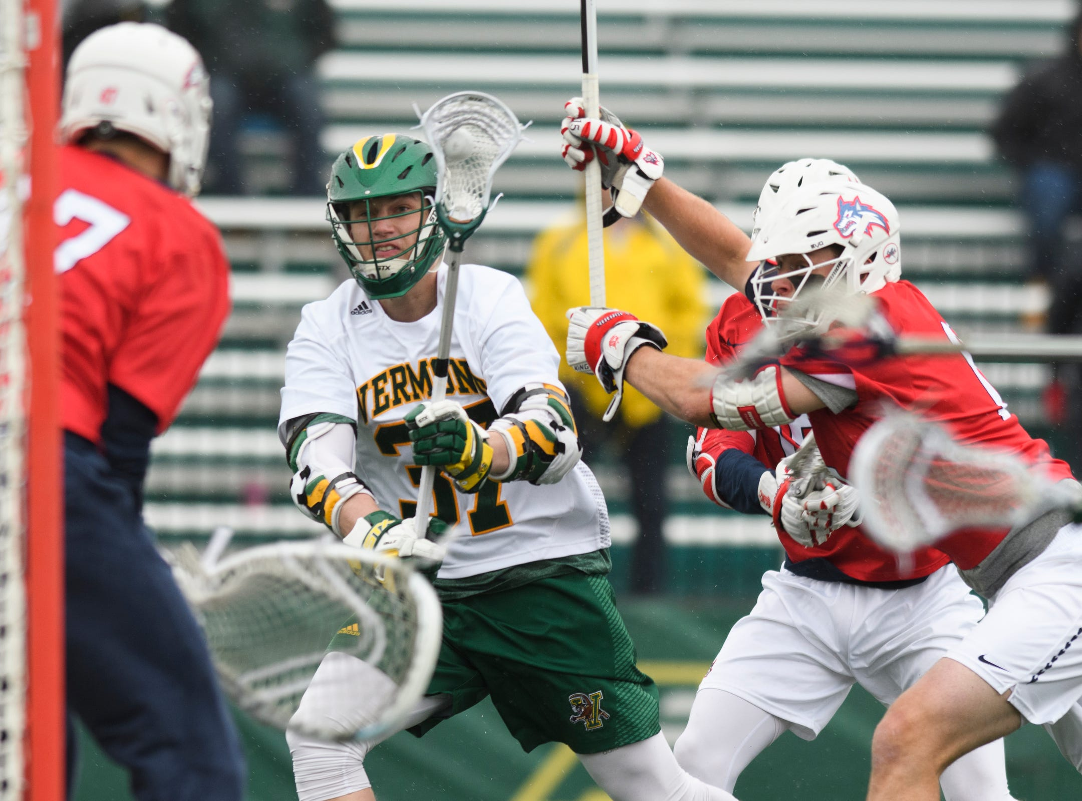 Vermont's Rob Hudson (37) shoots the ball during the men's lacrosse game between the Stony Brook Sea Wolves and the Vermont Catamounts at Virtue Field on Saturday afternoon April 20, 2019 in Burlington, Vermont.