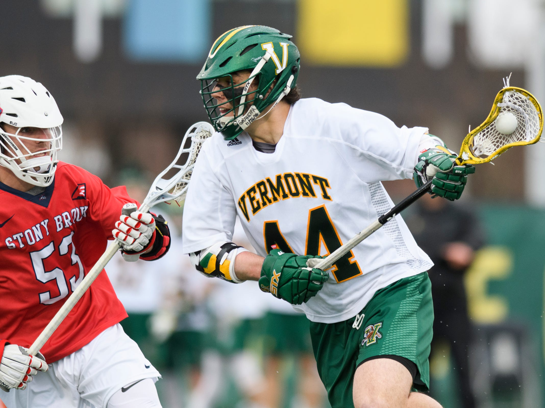 Vermont's Thomas McConvey (44) runs with the ball past Stony Brook's Caleb Pearson (53) during the men's lacrosse game between the Stony Brook Sea Wolves and the Vermont Catamounts at Virtue Field on Saturday afternoon April 20, 2019 in Burlington, Vermont.