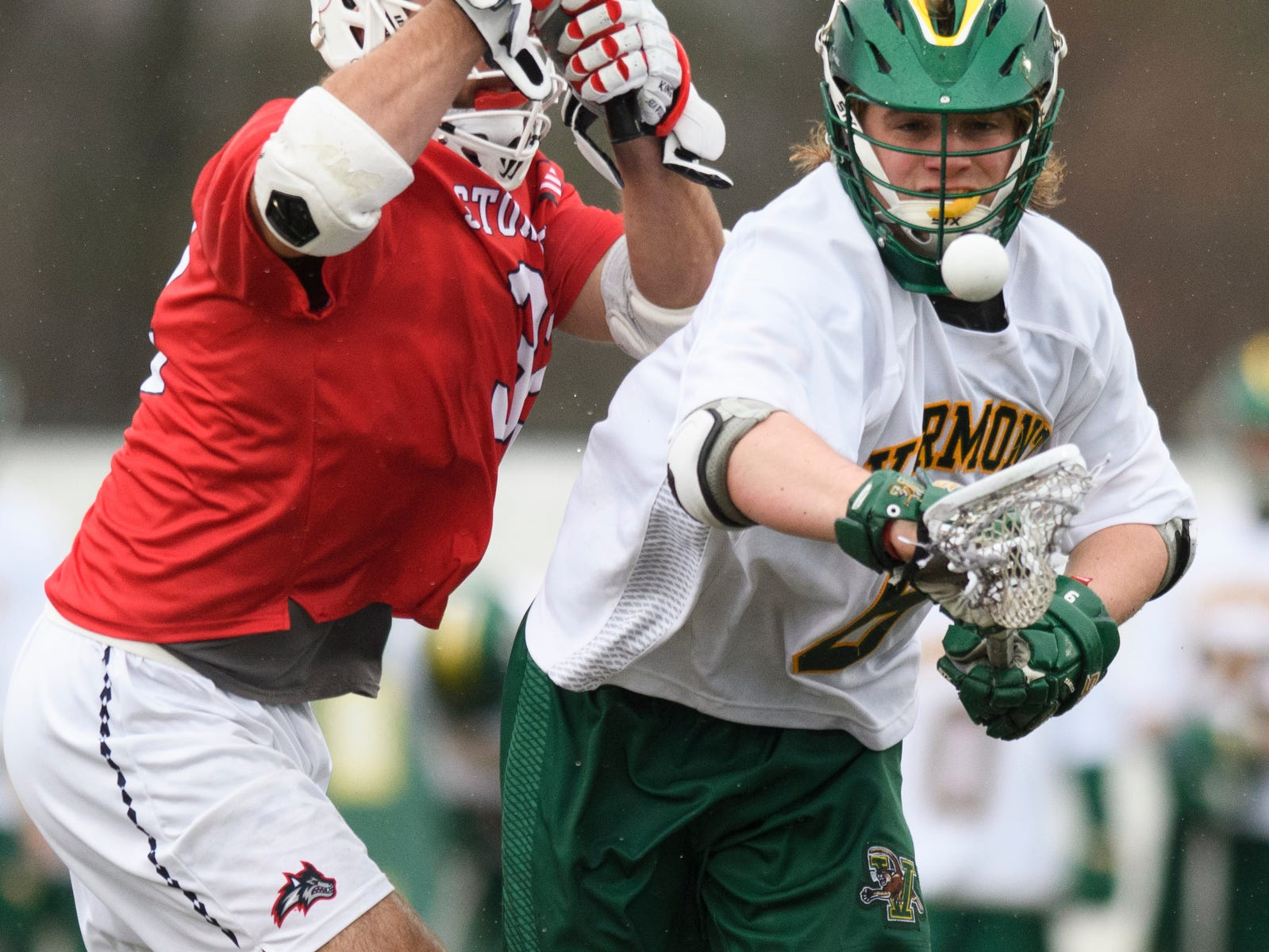 Vermont's Alex Semler (6) picks up the loose ball during the men's lacrosse game between the Stony Brook Sea Wolves and the Vermont Catamounts at Virtue Field on Saturday afternoon April 20, 2019 in Burlington, Vermont.