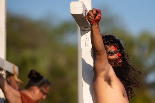 Jesus Christ, played by Rich Lockhart, is crucified during the 77th Easter Sunrise Passion Play at Cole Park on Sunday, April 21, 2019.