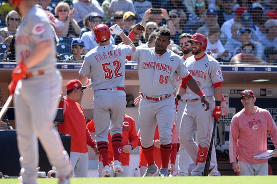 Cincinnati Reds first baseman Kyle Farmer (52) is congratulated at the dugout after hitting a home run during the seventh inning against the San Diego Padres at Petco Park.