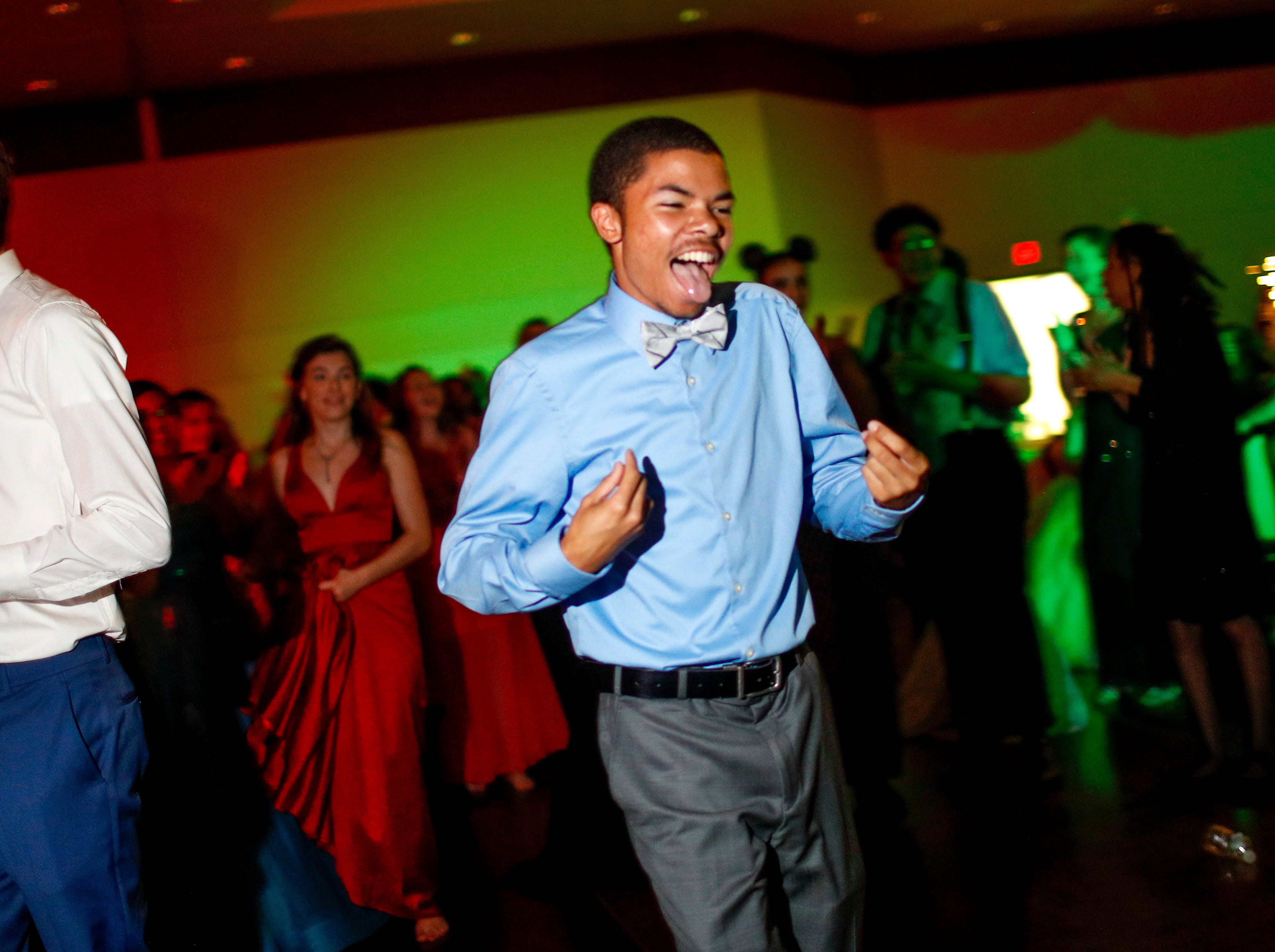 """Dionte Berry dances triumphantly to the front of the dance floor after being named Prom King at Fort Campbell High School's 2019 prom themed """"A Night in Athens"""" at Valor Hall in Oak Grove, KY., on Saturday, April 20, 2019."""