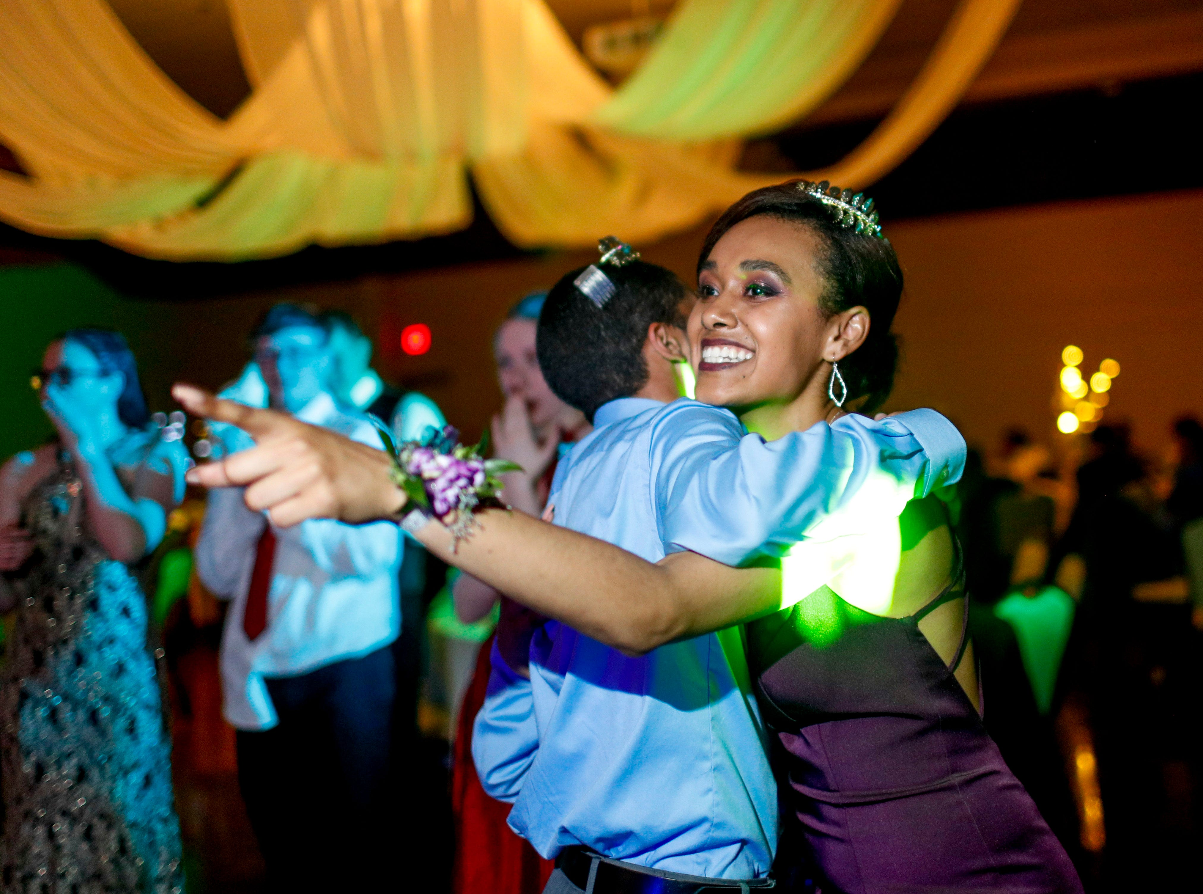 """Hannah Salas, after being named Prom Queen, embraces and dances with Dionte Berry, Prom King, at Fort Campbell High School's 2019 prom themed """"A Night in Athens"""" at Valor Hall in Oak Grove, KY., on Saturday, April 20, 2019."""