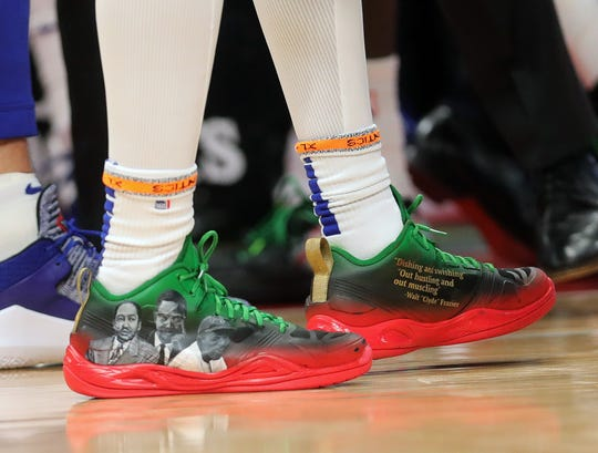 The hand painted Q4 shoes worn by Pistons guard Langston Galloway, March 10, at Little Caesars Arena.
