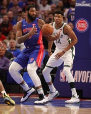 Detroit Pistons center Andre Drummond rebounds against  Milwaukee Bucks forward Giannis Antetokounmpo in the first quarter of Game 3 of the playoffs Saturday, April 20, 2019 at Little Caesars Arena.