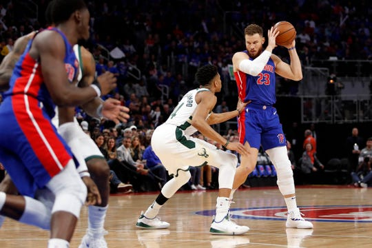 Detroit Pistons forward Blake Griffin defended by Milwaukee Bucks forward Giannis Antetokounmpo during the first quarter of Game 3 of the playoffs at Little Caesars Arena, April 20, 2019.
