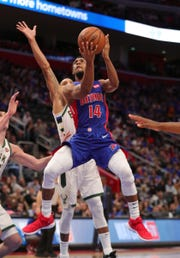 Detroit Pistons guard Ish Smith drives against Milwaukee Bucks guard George Hill during the third quarter of Game 3 of the playoffs Saturday, April 20, 2019 at Little Caesars Arena.