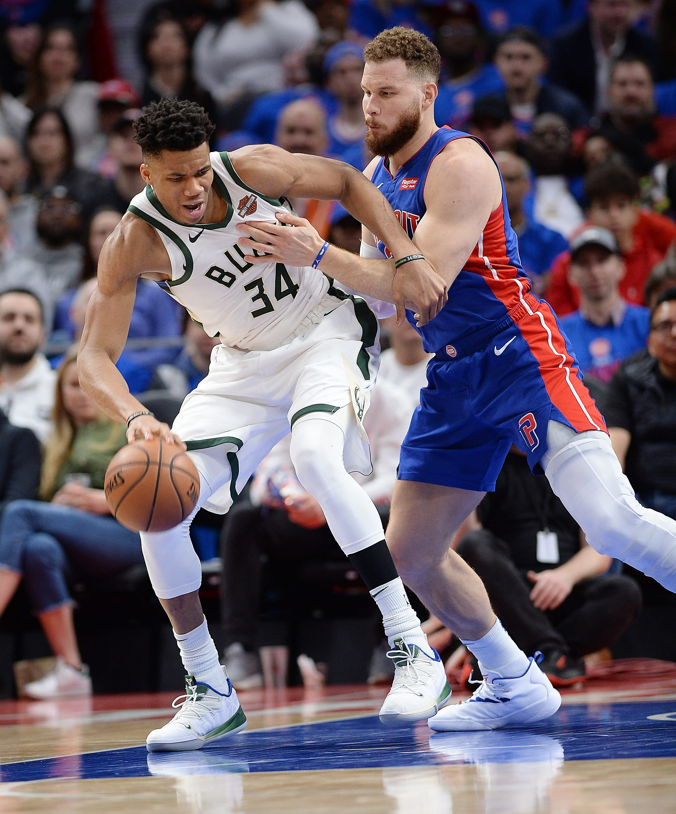 Bucks' Giannis Antetokounmpo drives around Pistons' Blake Griffin in the fourth quarter. Griffin finished with 27 points, but Detroit lost 119-103 to fall behind Milwaukee 3-0 in the first-round series.