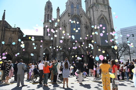 People let balloons go following at the Easter service at Fort Street Presbyterian Church in Detroit on April 21, 2019.  The church has the tradition of doing a balloon launch after the service.