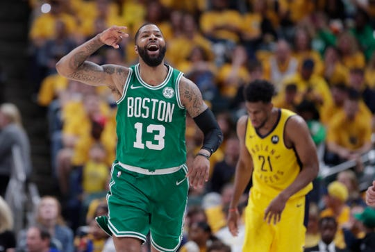 Celtics forward Marcus Morris (13) celebrates during the second half of Game 4 on Sunday.
