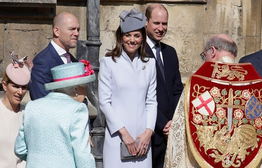 Members of Britain's Royal family watch as Britain's Queen Elizabeth II arrives to attend the Easter Mattins Service at St. George's Chapel, at Windsor Castle in England Sunday, April 21, 2019.