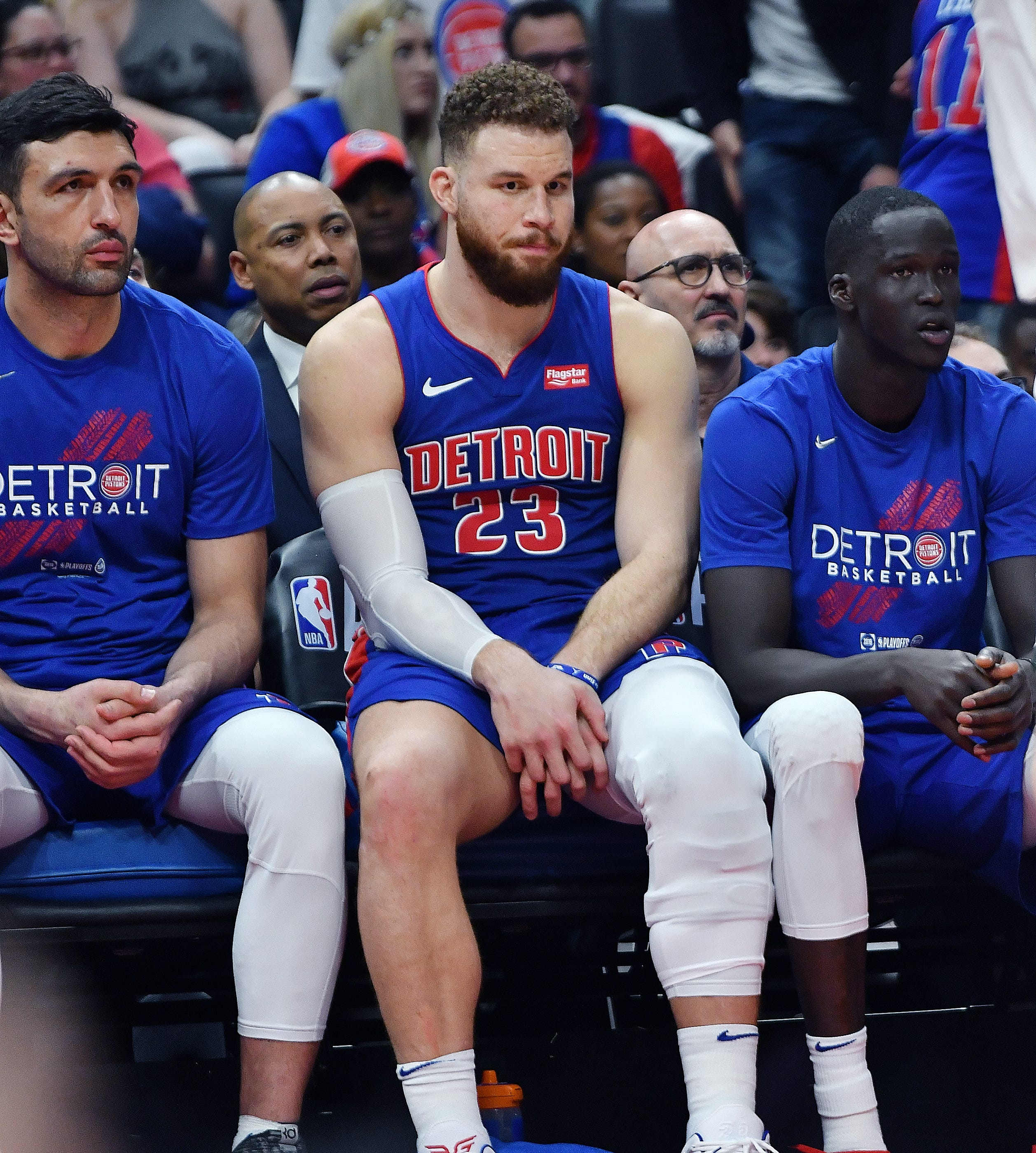 A dejected Blake Griffin, center, Zaza Pachulia, left, and Thon Maker sit on the bench late in the fourth quarter. Griffin had a game-high 27 points.