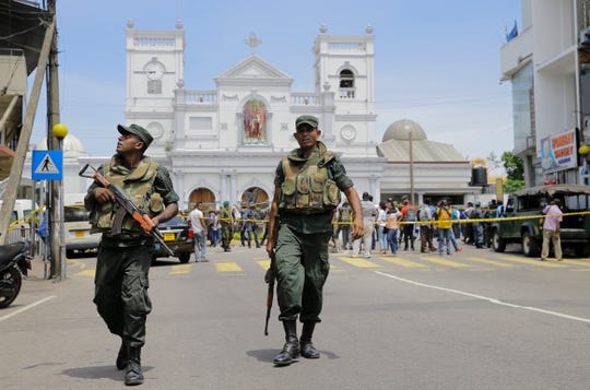 Sri Lankan Army soldiers secure the area around St. Anthony's Shrine after a blast in Colombo, Sri Lanka on Sunday.