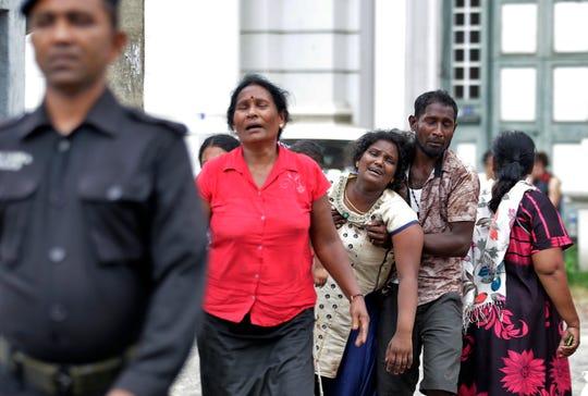 Relatives of a blast victim grieve outside a morgue in Colombo, Sri Lanka, Sunday, April 21, 2019.