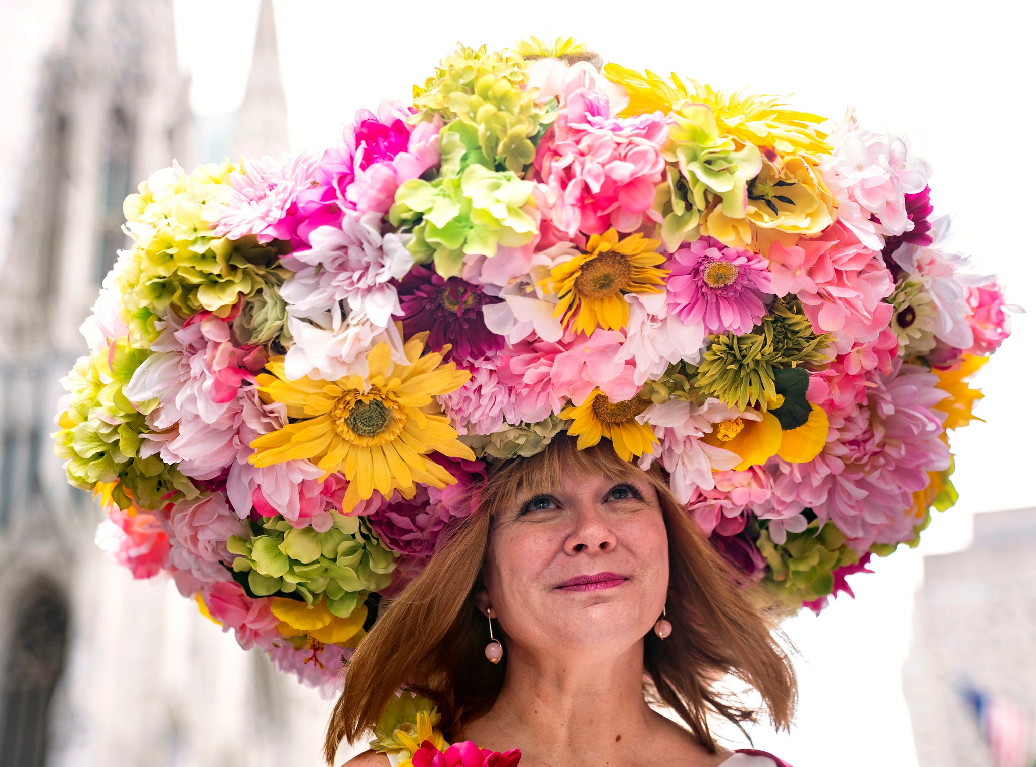 A costumed participant marches during the Easter Parade and Bonnet Festival, Sunday, April 21, 2019, in New York.