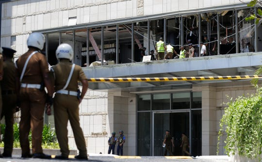 Police and forensic officials inspect a blast spot at the Shangri-la hotel in Colombo, Sri Lanka, Sunday, April 21, 2019.