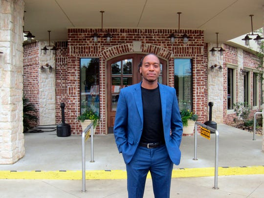 Jasper city council member Rashad Lewis stands in front of a restaurant in Jasper, Texas, after discussing the legacy of James Byrd Jr.'s death and its impact on Jasper.