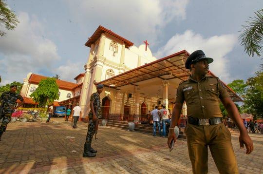 Sri Lankan army soldiers secure the area around St. Sebastian's Church damaged in blast in Negombo, north of Colombo, Sri Lanka, Sunday, April 21, 2019.