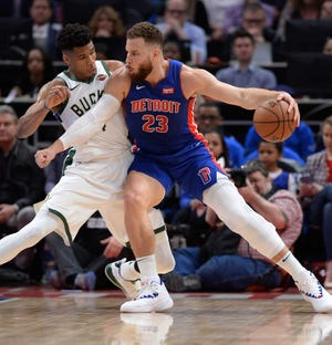 Pistons' Blake Griffin looks for room around Bucks' Giannis Antetokounmpo in the first quarter.
