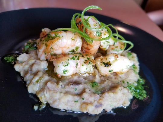 Shrimp in garlic sauce on plantain fufu at Latin Cuba Restaurant in Jasper.