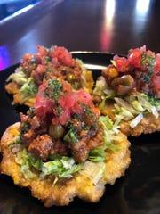 Tostones with lettuce, picadillo and tomato salsa at Latin Cuba Restaurant in Jasper.